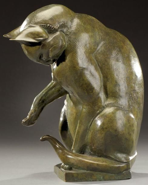 """SIRIO TOFANARI (1886-1969)    Bronze sculpture with green patina nuanced brown depicting a cat playing with its tail. Monogrammed """"ST"""". Cast old edition"""