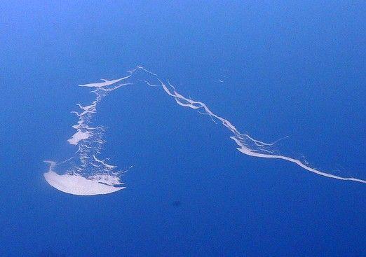 sperm-shaped island ~ I think it looks like a man of war jelly fish...