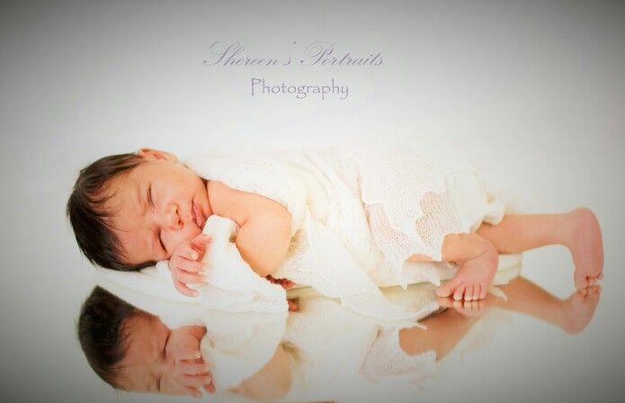 Newborn portrait on mirror. Www.shereensportraits.com