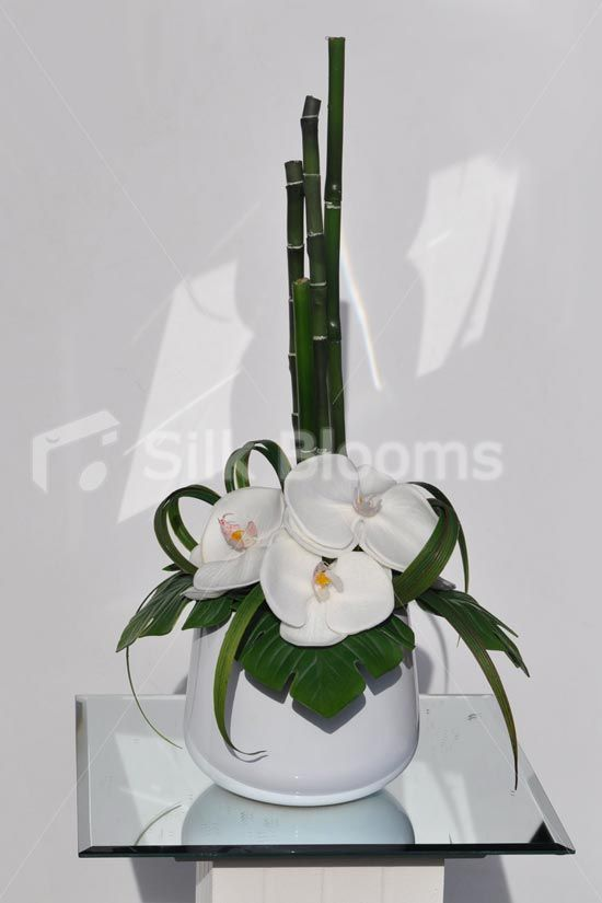 Small But Elegant White Orchid And Bamboo Table Vase