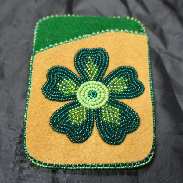 Beaded green clover card holder. Carry your debit, credit and I.D cards around in unique style with this card holder, beaded on moose hide with a green stroud interior and a beaded flower design.Hand crafted with care in Fort Liard, Northwest Territories in Canada's far North.�� Buy online now.