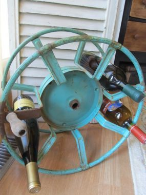 Fun Idea... Paint An Old Hose Reel And Use To Store Bottles (