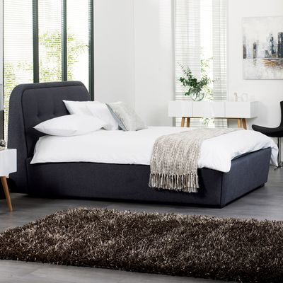 Soften up your bedroom with this padded felt bed.  Its cushioned headboard is great for sitting up and reading against and the slats lift up to reveal a plenty of internal storage space.  Its warm grey shade looks great with most bedding.