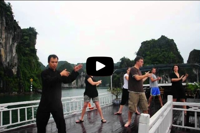 Tai Chi Exercise on V'Spirit Classic in Halong Bay. Special thanks to: - Photographer: Mr. Duong Thanh Tung - V'Spirit Sales Manager- Tai Chi Master: M