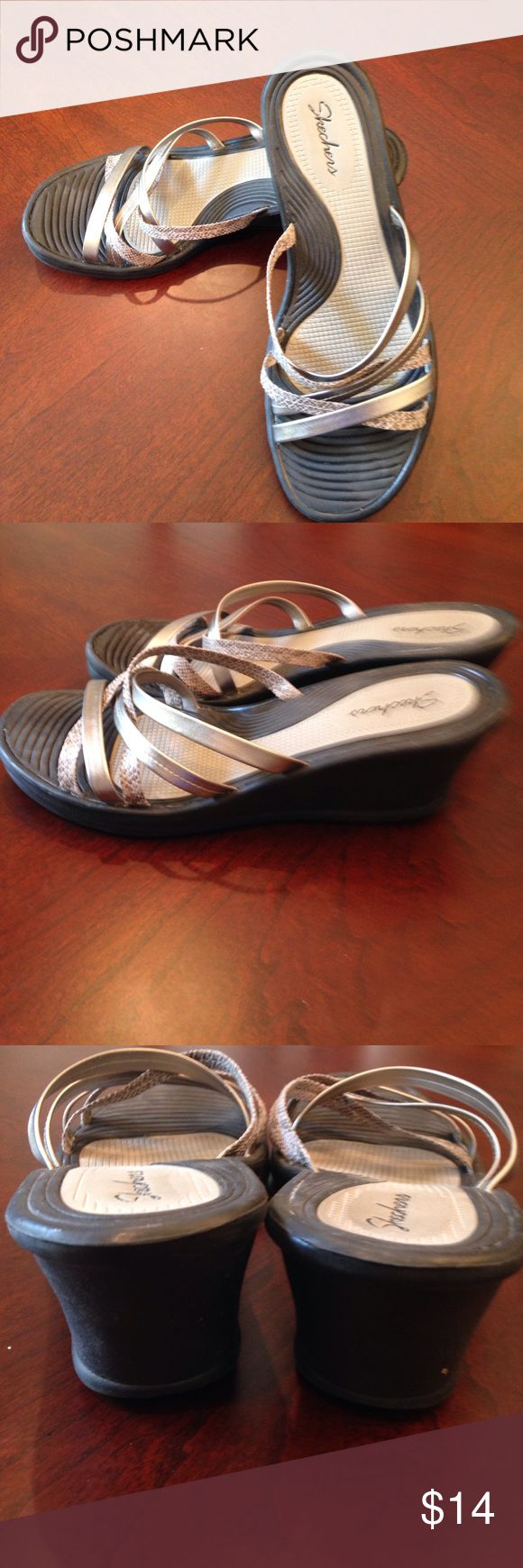 """Skechers strappy wedge sandals Super cute silver snakeskin and black wedge cushion heeled strappy sandals. Wear with shorts, jeans or dress and you're ready to go. 21/2"""" heels. Size 10. Skechers Shoes Wedges"""