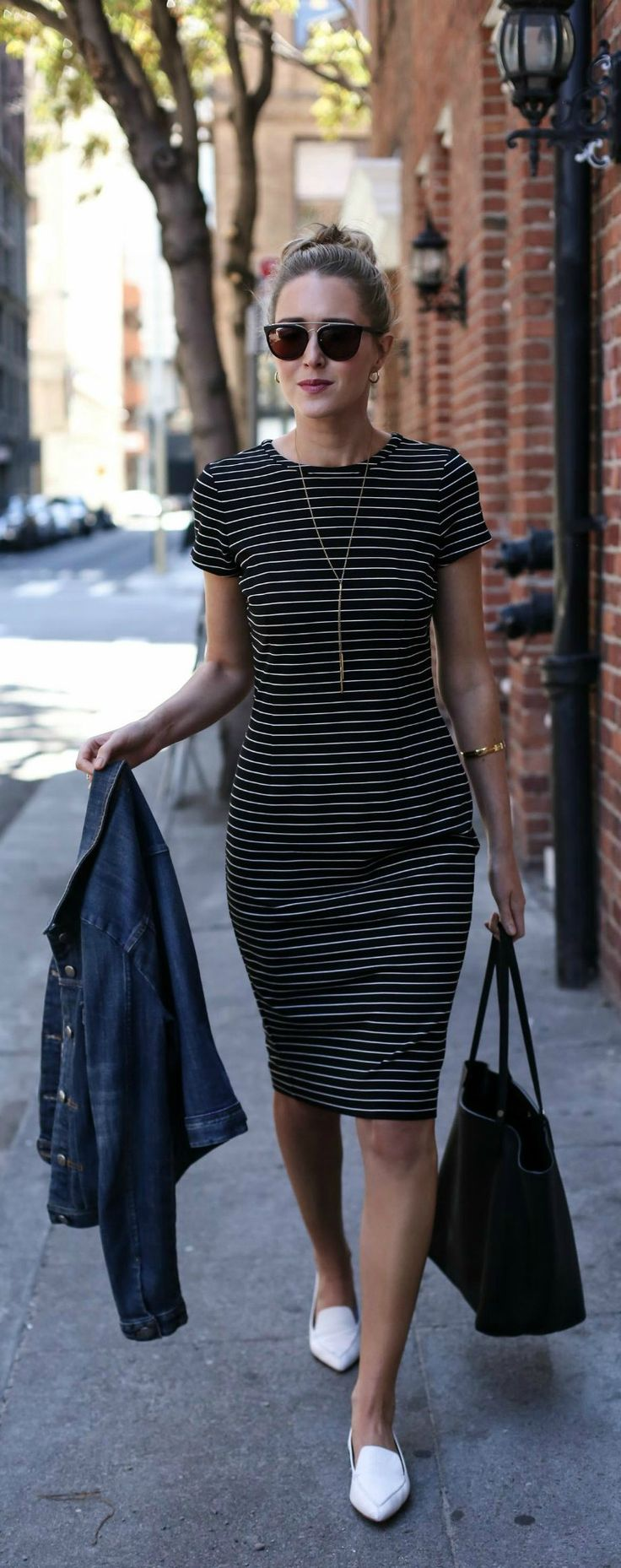 striped midi sheath dress, denim jacket, white pointed toe loafers, black tote bag, gold lariat necklace, black sunglasses + messy bun hairstyle {ann taylor, nicholas kirkwood, gigi new york, gorjana, smoke x mirrors}