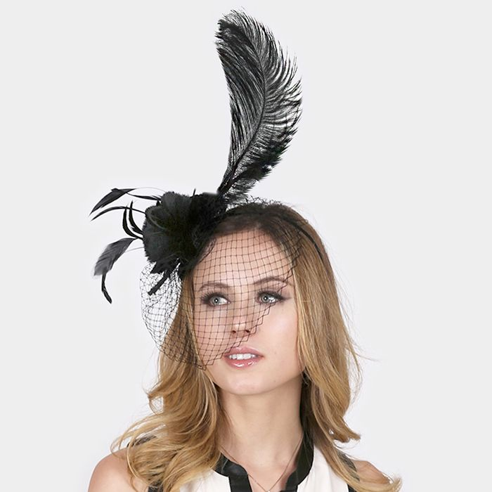 This black feather fascinator is a piece that compliments every derby day look. Order your beautiful, black derby hat online from Ginga's Galleria today!
