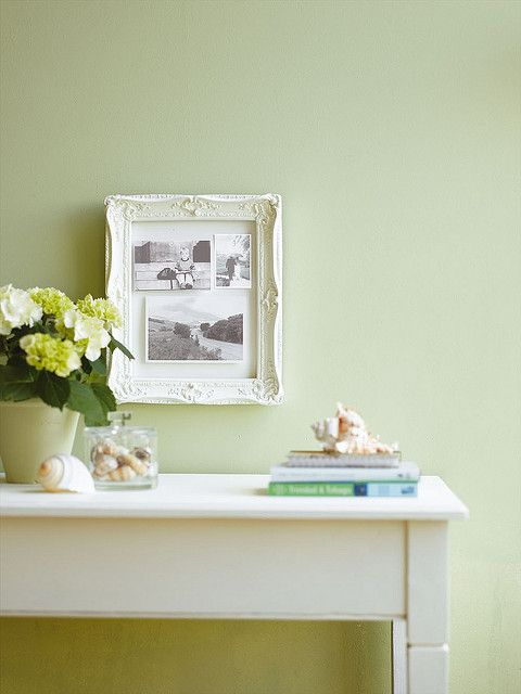 White frame against pale green wall by The Little Greene Paint Company, via Flickr