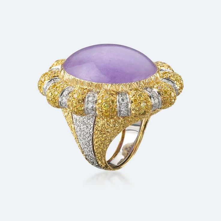Cocktail ring in white and yellow gold with lavender jade surrounded by the subtle light of white and yellow diamonds. Jade is the stone of the angels, transmitting spiritual energy to whoever touches or even just looks at it. Jade in all its forms has always been very much loved by nobles, especially the nobles of spirit. Http://www.facebook.com/diamonddreamfinejewelers http://www.twitter.com/diamond_dream_ http://www.instagram.com/diamonddreamjewelers