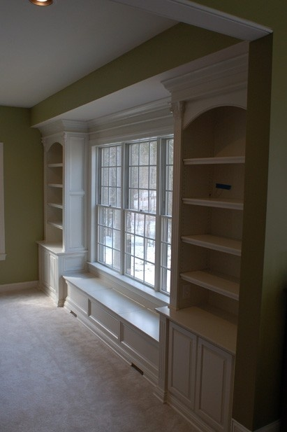 white bookshelves with bench