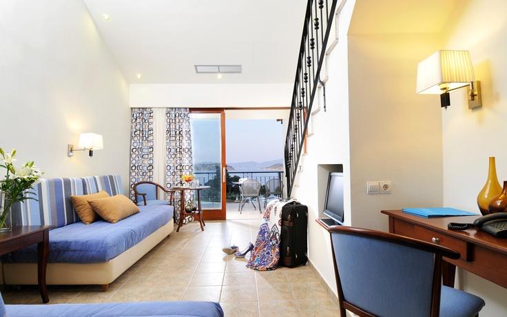 Inside the Maisonette of the Kassandra Bay Hotel & Resort in Skiathos. Desk, sea view, sofa. Visit www.kassandrabay.com/maisonettes-skiathos for more information.