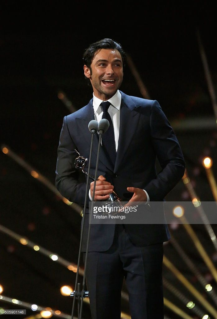 Aidan Turner accepts the award for Best Impact/TV Moment at the 21st National Television Awards at The O2 Arena on January 20, 2016 in London, England.