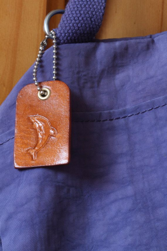 Handmade Dolphin Bag Charm by Tina's Leather Crafts on Etsy.com.  Repin To Remember.