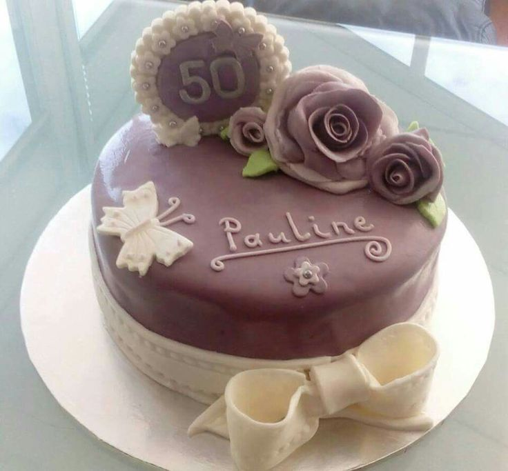50th birthday cake with fondant roses, butterflies and plaque.