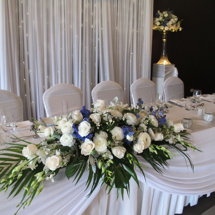 long and low arrangement for bridal table