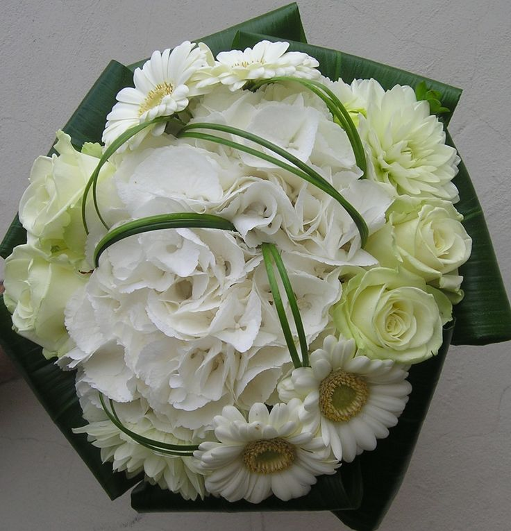 A modern hand-tied posy using Hydrangea, Germini, Roses, Dahlia's, Aspidistra leaves and steelgrass. Created by Floresta.co.uk