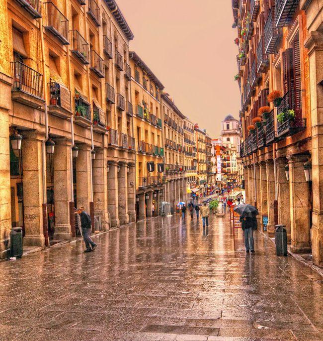 Calle Toledo in a rainy winter day. Madrid.