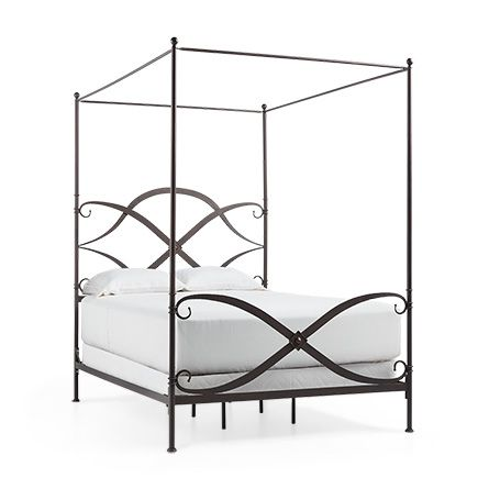 Evocative of the swirling shapes forming a traditional British family crest, the swooping lines of our St. Lucia Queen Canopy Bed infuses solid wrought iron with a sense of lightness and fluidity that appears to float on air.