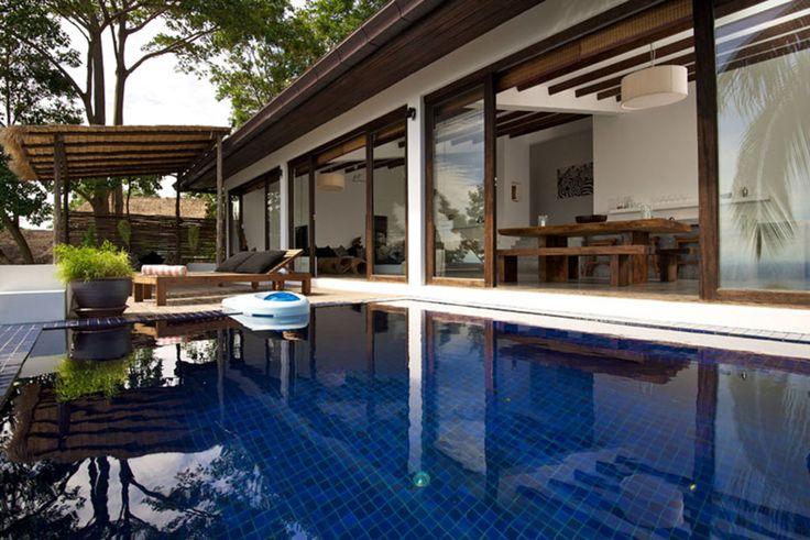 Modern Tropical Pool Design with Modern Blue Tiles Pool Deck ...