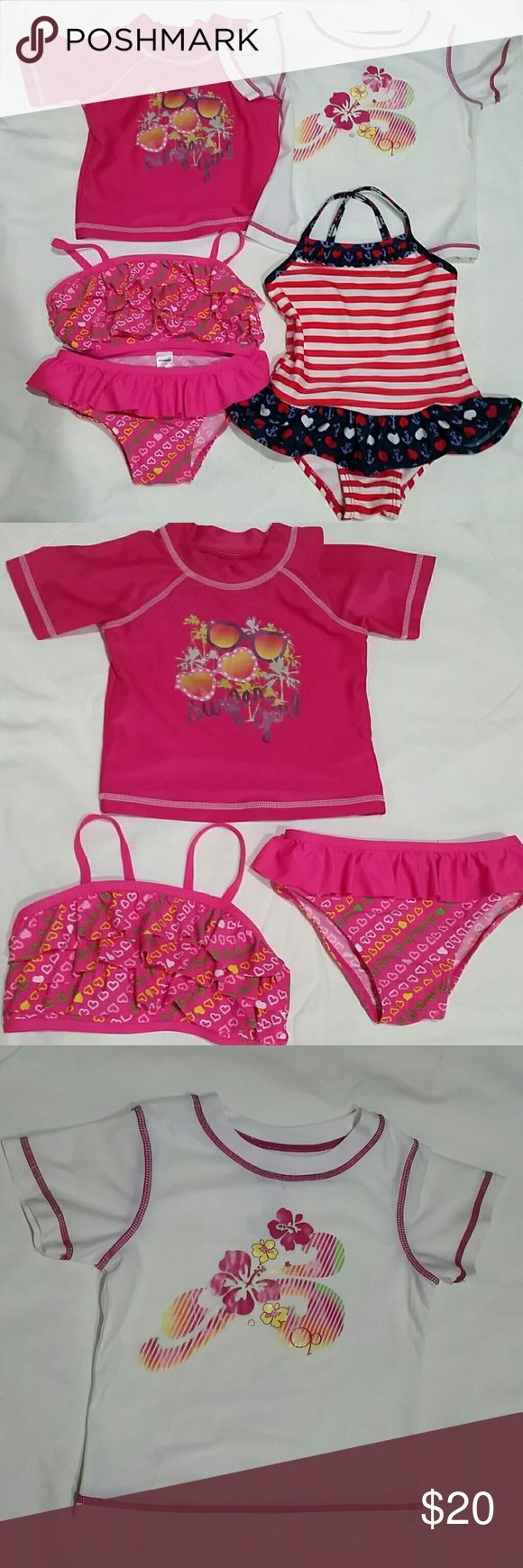 3T Swimwear Bundled Lot This listings includes 2 rash guards, a bikini, and a 1 piece. All pieces in this lot are size 3T. All are in excellent used condition. The brands included are Joe Boxer and OP.  The pink rash guard is Joe Boxer, and the white rash guard is Op. Both match well with the pink bikini.  The pink 2 piece has ruffles and hearts and is by Joe Boxer.   The 1 piece has red and white stripes and a navy ruffle, featuring hearts and anchors. Joe Boxer Swim