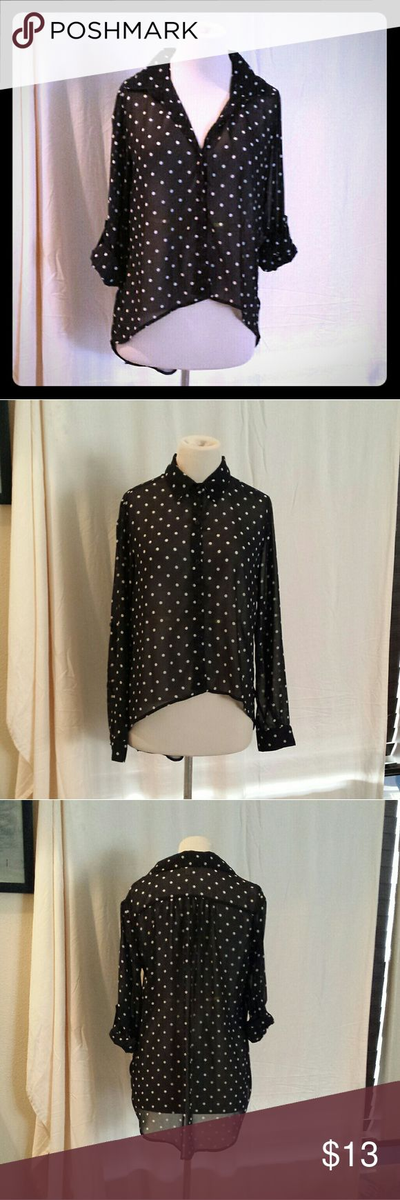 Marisol Polka Dot Slouchy Hi-Low Blouse Super easy to wear different ways!  Only 2 pictured, more variations possible.   Button holes are showing signs of use,  so I included a pic.   Can be long sleeve or 3/4 sleeve  LAYING FLAT-  Length: 22in  Pit to pit: 23in Waist: 21in    #black #white #blackandwhite #polkadots #dots #loose #slouchy #buttons #buttonup #convertible #airy #silky #fancy #cute #flirty #seethrough #chiffon #hilow #highlow #classy #classic #neutral #goeswitheverything #work…