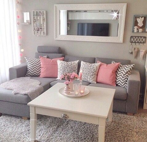 I would so have a lounge room like this if I didn't have to worry about the husbands thoughts haha pink and gold and grey!