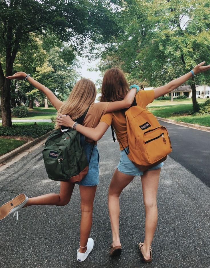 Friend back backpack road street pavement hold hug cuddles