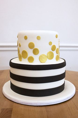 black and white striped cake with gold polka dots