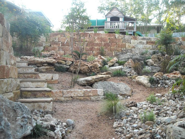 backyard landscape limestone retaining wall in the midst