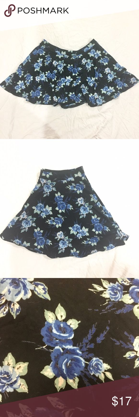 """Floral skater skirt Black skater skirt with blue floral pattern. Has a stretchy waistband. Waist: 17 1/2"""" across, length: 18"""". Never worn, in great condition. Feel free to make me a reasonable offer 💕 LC Lauren Conrad Skirts Circle & Skater"""