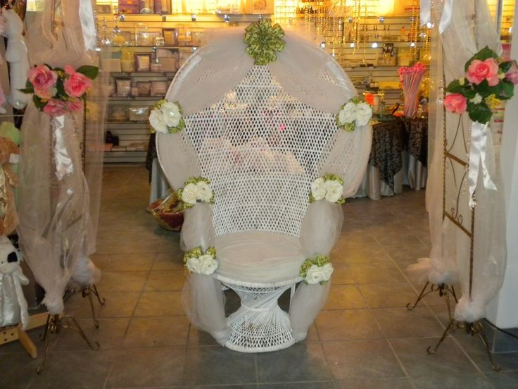 decorating a peacock wicker chair of a bridal shower. Black Bedroom Furniture Sets. Home Design Ideas