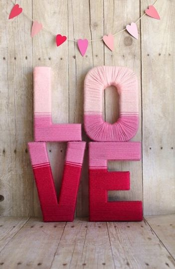 "Oversized letters wrapped in yarn. ""PLAY"" would be great for the big playroom wall!"