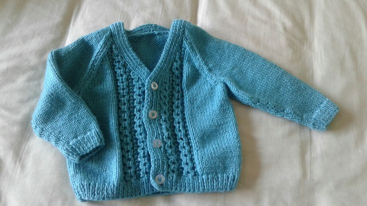 Sirdar Baby Vintage by Snuggly 434. Design 1415 cardigan in double knit for Isobel.  Simple and easy to knit up, but effective with the pattern up the front.