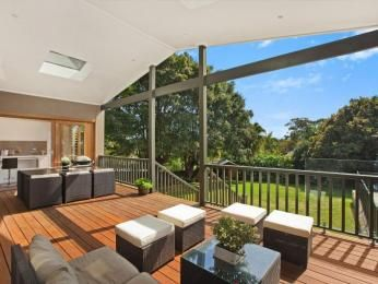 Indoor-outdoor outdoor living design with bbq area & outdoor furniture setting using timber - Outdoor Living Photo 1364135