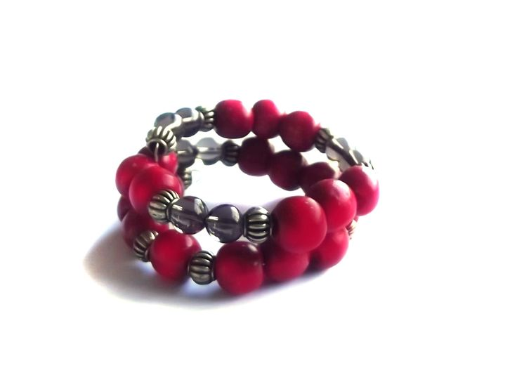 Red and gold bracelet with smokey quartz in spiral form.  To find price visit website.