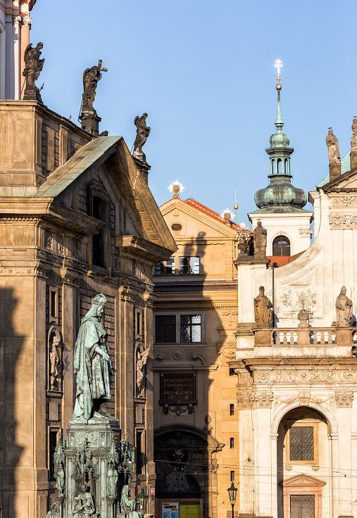 Located at Knights of the Cross Square, this statue depicts Charles IV., the Holy Roman Emperor and King of Bohemia..The church of Saint Salvator (right) and St.Francis of Assisi (left) next to the Charles Bridge with the motherhouse of the Knights of the Cross with the Red Star, Prague, Czechia #prague #Czechia
