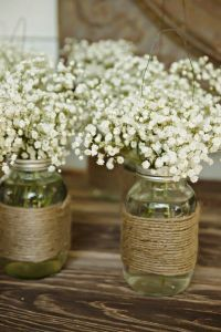 rustic wedding flower - canning jar with jute and baby's breath