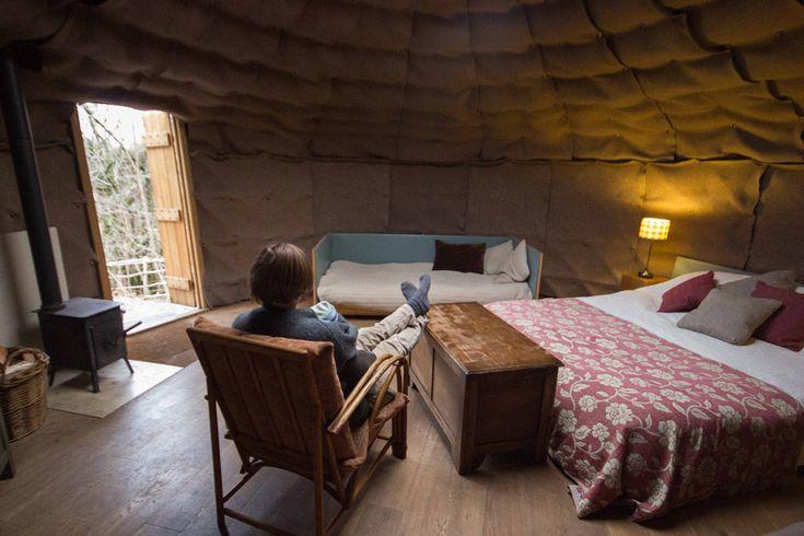 A yurt in a wooded setting in Cumbria, UK.