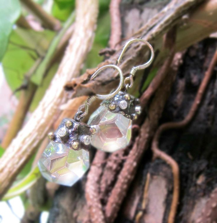 Sweet silver oxidation with brass granules, CZ, and Glass. Shine to the world! :)