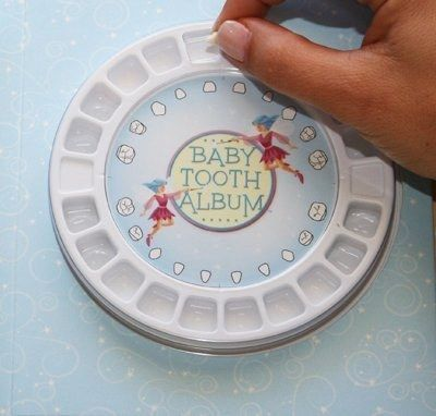 This baby tooth album is a nice way to display and save baby teeth.