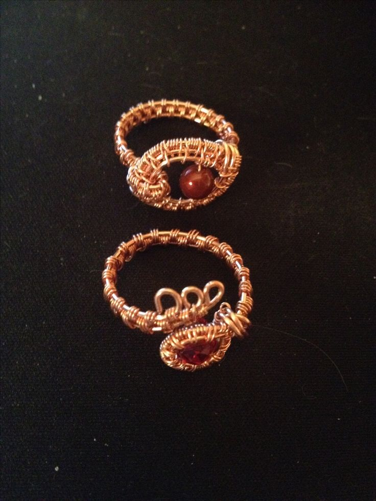 Two pure copper rings.  The one on the bottom is adjustable.