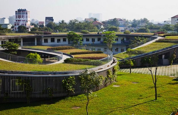 Vo Trong Nghia Architects have designed a knot-shaped school building, complete with a functioning farm on its roof to educate 500 preschool children on the importance of sustainable education and design. Built in the tropical climate of south east Vietnam, the 'Farming Kindergarten' features an accessible green roof that can grow plants and produce all year round.