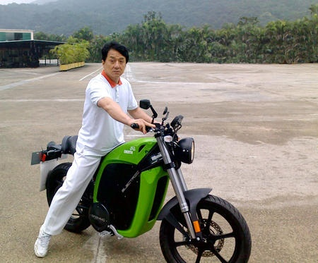 Jackie Chan riding a Brammo Enertia.