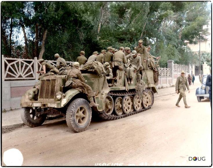 Deutsches Afrika Korps ( DAK ) prisoner`s , in a Luftwaffe SdKfz 7 Krauss-Maffei Half Track ( WL-35239 ) - having surrendered to the British 7`th Armoured Division in Tunis . May 1943
