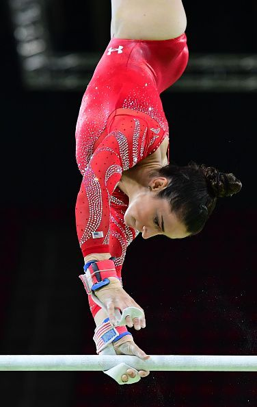 #RIO2016 US gymnast Alexandra Raisman practices on the uneven bars of the women's Artistic gymnastics at the Olympic Arena on August 4 2016 ahead of the Rio...