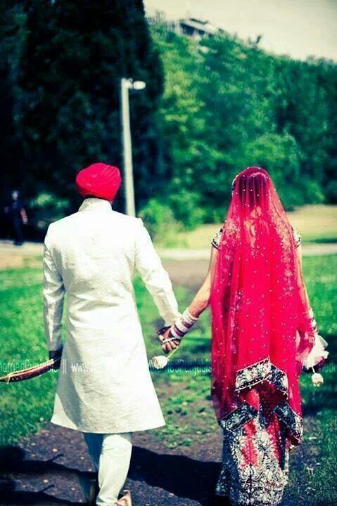 Punjabi wedding couples holding hands