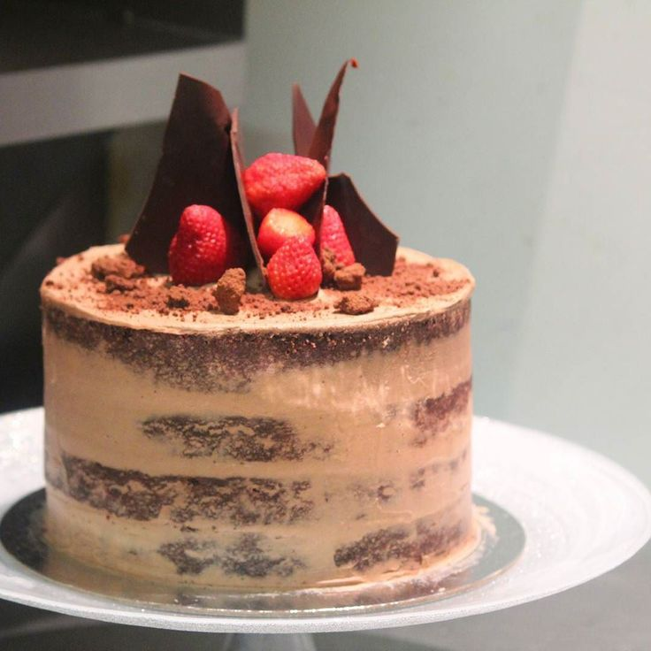 Birthday cake for our Boss man! 4 layered semi-naked Chocolate Victoria sponge. Vanilla bean Mascarpone chocolate buttercream with chocolate soil and shards. Click the link in our bio to view our cake menu for your next special occasion!