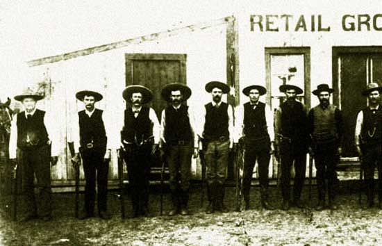 """Texas Rangers in Cotulla, Texas, Feb. 1887. Cotulla cowboys were rough, so much so that allegedly when a train pulled into the Cotulla station, the conductor would call out """"Cotulla! Everybody get your guns ready.""""There were shooting on Front Street, Sheriff McKinney was murdered which resulted in further gunfights. There were illegal hangings. The governor had to send in a troop of Texas Rangers."""