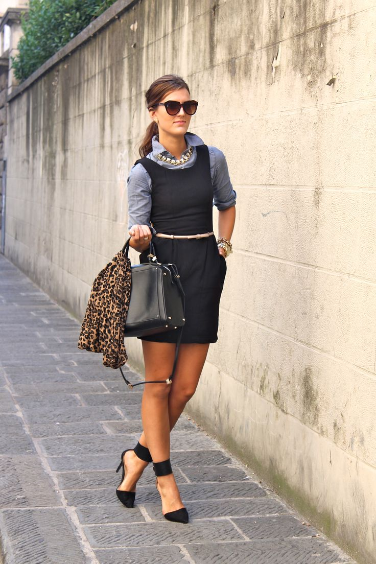 Chambray shirt under sleeveless sheath dress animal print belt black heels statement necklace