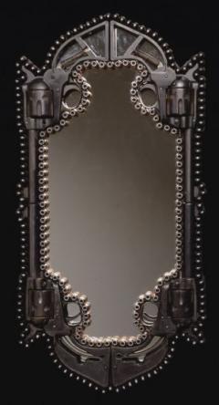 Awesome gun mirror by Al Farrow. Would look badass in a man cave bathroom!